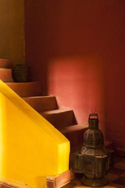 Morocco. An old lantern and jug on steps of a restored Kasbah with a texture overlay. by Brenda Tharp