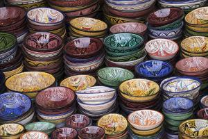 Morocco, Marrakech. Colorfully painted ceramic bowls for sale in a souk, a shop. by Brenda Tharp