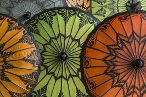 Myanmar, Bagan. Handmade and Painted Parasols on Display in a Shop by Brenda Tharp