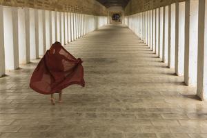 Myanmar, Bagan. Young Monk Walks the Hallway of Shwezigon Monastery in Bagan by Brenda Tharp