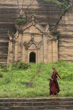 Myanmar, Mingun. a Young Monk Walking Beneath a Massive Temple Wall at Ruins of Mingun Pahtodawgyi by Brenda Tharp