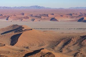 Namibia. Aerial view of the vast red dune fields of Sossusvlei in Namib-Naukluft National Park. by Brenda Tharp