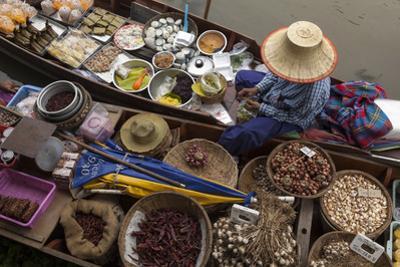 Thailand, Amphawa Floating Market. Woman prepares food. by Brenda Tharp