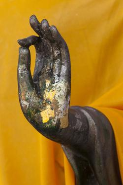 Thailand. Buddha Statue hand with gold leaf tokens. by Brenda Tharp