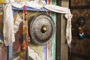 The worn brass gong outside temple entrance, Trongsa Dzong, Bhutan by Brenda Tharp