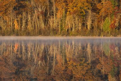USA, Wisconsin. A cold morning on a Mill pond Lake in Autumn.