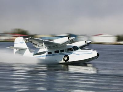 Float Plane Taking Off from Lake Hood, Anchorage, Alaska by Brent Winebrenner