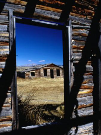 Hut Framed by Window of Burnt Log Cabin, Wind River Country, Lander, USA by Brent Winebrenner