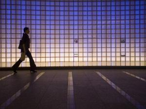 Pedestrian in a Neon-Lit Passageway in Namba Station by Brent Winebrenner