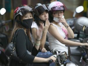Teenage Bikers Sitting on Bikes, Keelung, Taipei, Taiwan by Brent Winebrenner