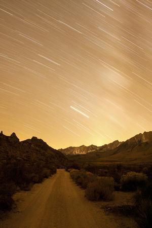 A Long Exposure Creates a Star Trail Above a Road in the Eastern Sierra Near Bishop, California