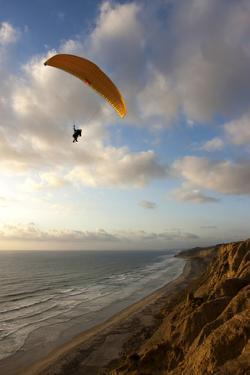 A Male Paraglider at the Torrey Pines Gliderport in San Diego, California by Brett Holman