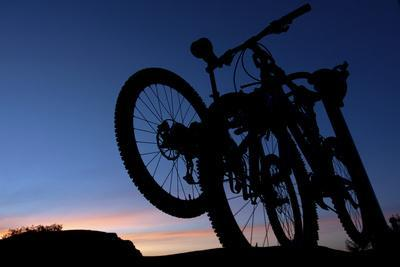 A Silhouette of Two Mountain Bikes on Car Rack in Red Rock Canyon in Nevada