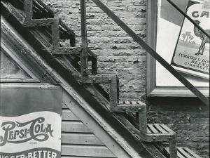 Staircase and Advertisements, New York, c. 1945 by Brett Weston