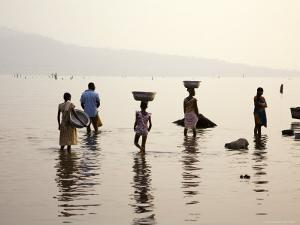 Ghanaians Collecting Water from Lake Volta at Dusk by Brian Cruickshank