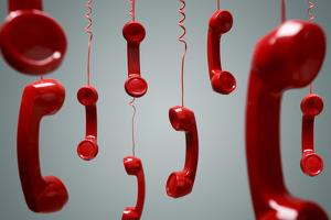 Red Telephone Receiver Hanging by Brian Jackson