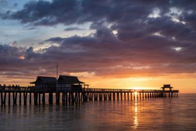 Colorful sunset over the Naples Pier, Naples, Florida, USA by Brian Jannsen