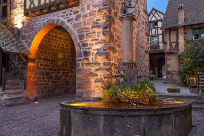 Evening at the medieval entry gate, Riquewihr, Alsace, Haut-Rhin, France by Brian Jannsen