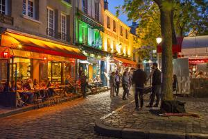 Evening Scene in Place Du Tertre, Montmartre, Paris, France by Brian Jannsen