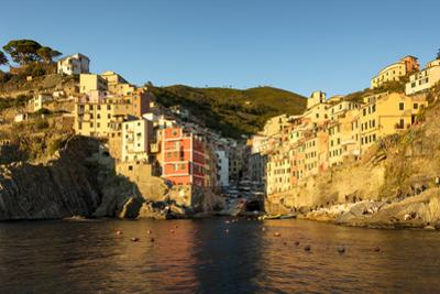 Setting sunlight on the town of Riomaggiore, one of the Cinque Terre, Liguria, Italy by Brian Jannsen