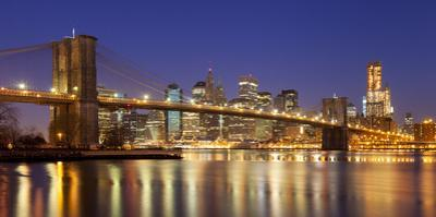The Brooklyn Bridge and buildings of Lower Manhattan financial district, New York City USA by Brian Jannsen