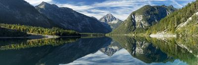 Tyrolean Alps reflected in Plansee, Tyrol, Austria by Brian Jannsen