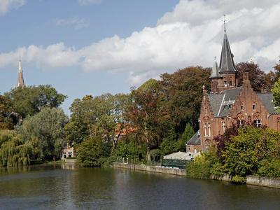 https://imgc.allpostersimages.com/img/posters/brick-church-on-minnewater-lake-bruges-belgium_u-L-PHASHB0.jpg?p=0