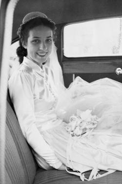 Bride in the Backseat of Car, Ca. 1950