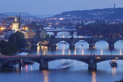 https://imgc.allpostersimages.com/img/posters/bridges-over-the-vltava-river-including-charles-bridge_u-L-PQ8TKZ0.jpg?artPerspective=n