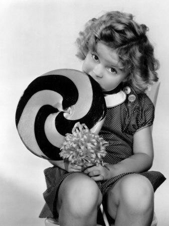 https://imgc.allpostersimages.com/img/posters/bright-eyes-shirley-temple-eating-a-big-lollipop-1934_u-L-P6S66Y0.jpg?artPerspective=n