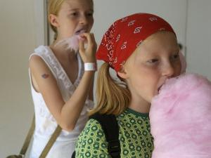 Tivoli, Two Sisters Eat Cotton Candy at the Park, Copenhagen, Denmark by Brimberg & Coulson
