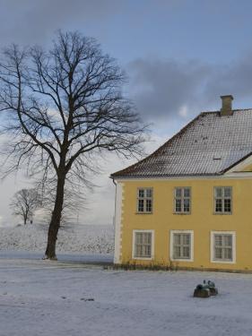 Yellow House in Snow, Copenhagen, Denmark by Brimberg & Coulson