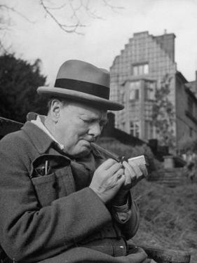 Britain's Prime Minister Winston Churchill Lighting a Cigar