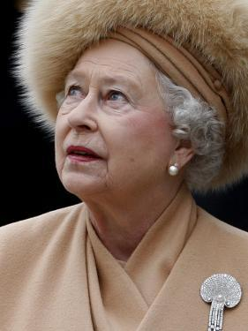 Britain's Queen Elizabeth II Looks Up at the Statue of Her Mother at the Unveiling Ceremony