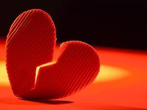 Broken Cardboard Heart in Romantic Light