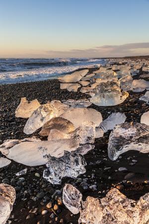 https://imgc.allpostersimages.com/img/posters/broken-ice-from-washed-upiicebergs-on-jokulsarlon-black-beach-at-sunrise_u-L-PWFKK30.jpg?p=0