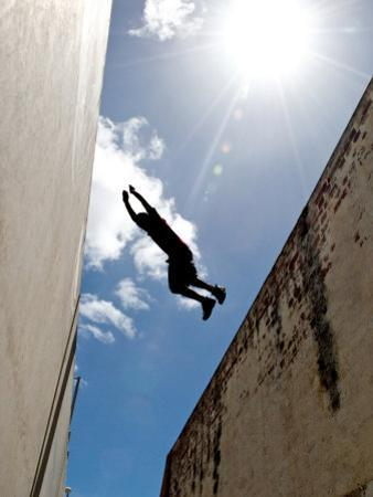 Parkour Practitioner Jumps a Building Gap in Adelaide, Sa