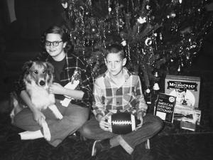 Brother and Sister Pose by the Christmas Tree, Ca. 1960