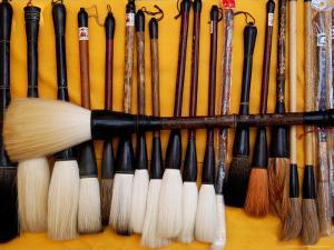 Brushes at a Chinese Street Market, China by Bruce Behnke