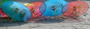 Umbrellas For Sale on the Streets, Shandong Province, Jinan, China by Bruce Behnke