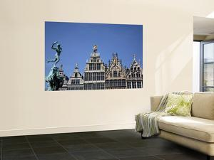 Statue of Brabo Fountain in Grote Markt (Town Square) with Guilds Houses in Background by Bruce Bi