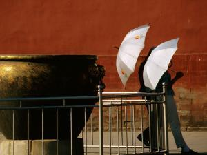 Two Young Women with Umbrellas Standing Beside Water Urn, Forbidden City by Bruce Bi
