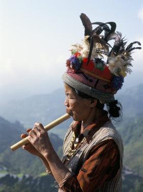 Ifugao Person Playing a Pipe, Northern Area, Island of Luzon, Philippines, Southeast Asia by Bruno Barbier