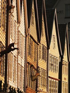 Row of Wooden Houses in Bryggen by Bruno Ehrs
