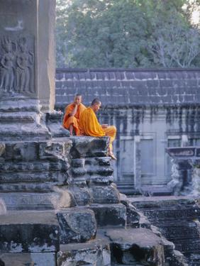 Buddhist Monks at the Temple Complex of Angkor Wat, Angkor, Siem Reap, Cambodia, Indochina, Asia by Bruno Morandi