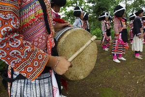 Long Horn Miao Girls in Traditional Costumes Celebrating Flower Dance Festival by Bruno Morandi