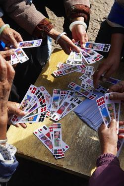 Naxi Women Playing a Local Game of Cards, Lijiang, Yunnan, China, Asia by Bruno Morandi