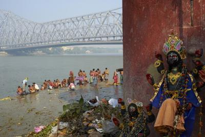 People Bathing in the Hooghly River from a Ghat Near the Howrah Bridge