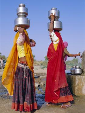 Two Women by a Well Carrying Water Pots, Barmer, Rajasthan, India by Bruno Morandi