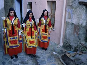 Women Holding Candles, Corpus Domini Procession, Desulo (Gennargentu), Sardinia, Italy by Bruno Morandi